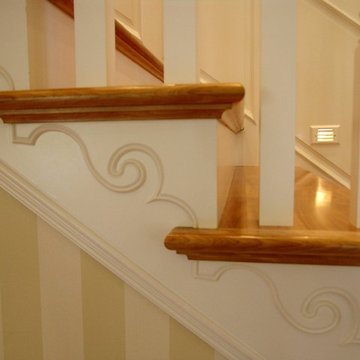 Traditional stair with painted wainscoting