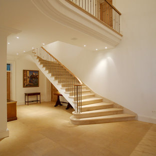 Inspiration for an expansive traditional curved staircase in Other.