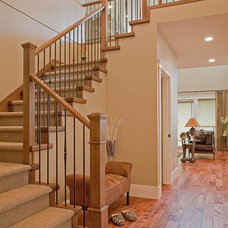 Traditional Staircase by Clay Construction Inc.
