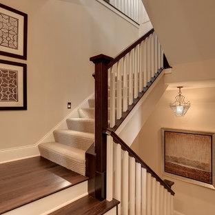 Elegant wooden staircase photo in Minneapolis