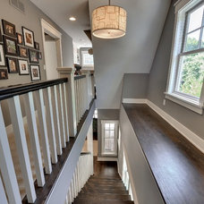Traditional Staircase by Highmark Builders