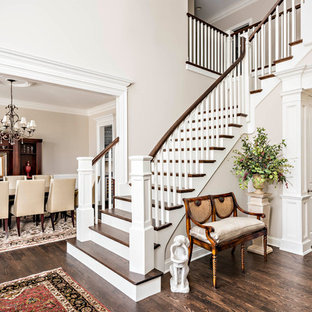 Example of a classic wooden l-shaped wood railing staircase design in Chicago with painted risers