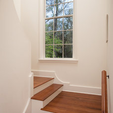 Traditional Staircase by Thomas Thaddeus Truett Architect