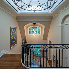 Traditional Staircase by Makow Associates Architect Inc