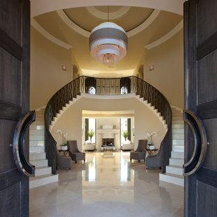Idéer för mycket stora funkis svängda trappor i travertin, med sättsteg i travertin och räcke i metall