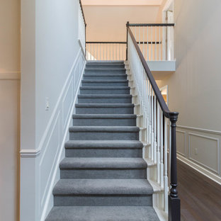 Inspiration for a large transitional carpeted straight staircase remodel in Detroit with carpeted risers