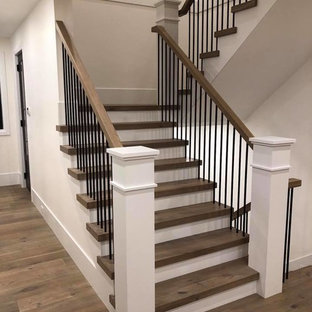 Inspiration for a large transitional wooden u-shaped mixed material railing staircase remodel in Vancouver with painted risers