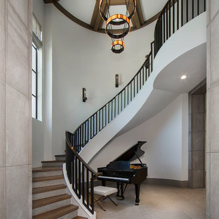 Inspiration for a transitional wooden curved staircase remodel in Dallas