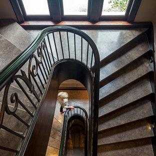 Inspiration for a huge timeless concrete spiral staircase remodel in Toronto with concrete risers
