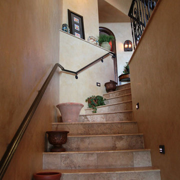 Travertine Staircase with Venetian Plaster Walls