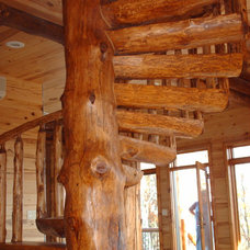 Traditional Staircase by NWC LOG&TIMBER LLC