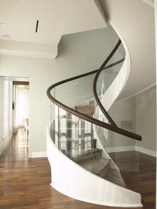 Mid Sized Contemporary Wooden Curved Staircase Idea In New York