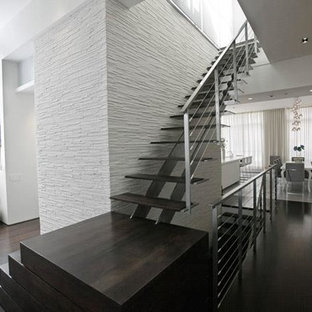 Mid-sized minimalist wooden u-shaped staircase photo in New York with metal risers