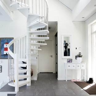 This is an example of a scandinavian spiral staircase in Other with open risers.