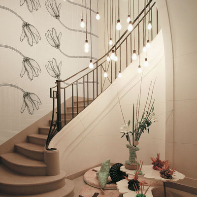 Example of an eclectic curved staircase design in Other