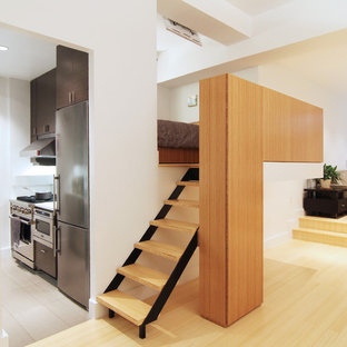 Staircase - small modern wooden straight open staircase idea in New York