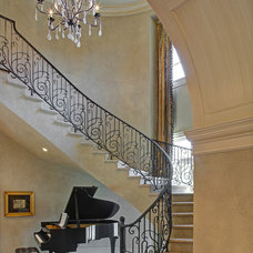 Mediterranean Staircase by Great  Falls Distinctive Interiors Inc.