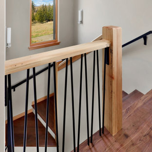 Staircase - mid-sized rustic wooden u-shaped metal railing staircase idea in Seattle with wooden risers