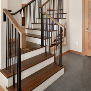 Example of a mid-sized mountain style wooden u-shaped metal railing staircase design in Seattle with wooden risers