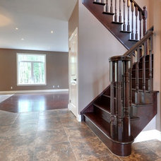Traditional Staircase by Quality Construction Services