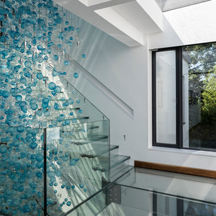 Staircase - large contemporary glass floating staircase idea in Berkshire with glass risers