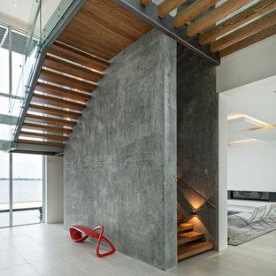 Modelo de escalera en U, contemporánea, sin contrahuella, con escalones de madera