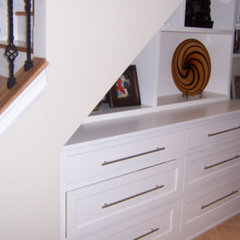 contemporary staircase by Kent Cabinetry and Millwork Inc