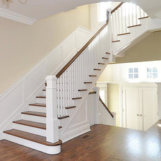 Traditional Staircase by Oasis Architecture