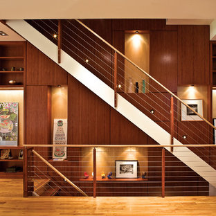 Staircase - contemporary wooden straight staircase idea in New York
