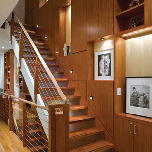 Inspiration for a contemporary wooden staircase remodel in New York