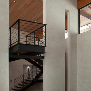 Example of a huge minimalist painted floating open staircase design in New York