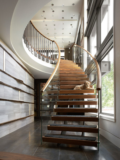 Trendy Wooden Curved Open Staircase Photo In Chicago