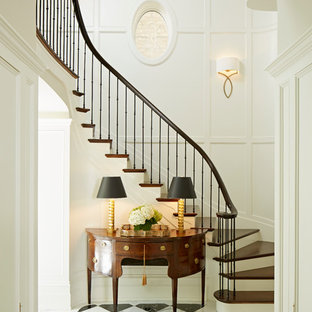 Example of a classic wooden staircase design in Chicago with painted risers