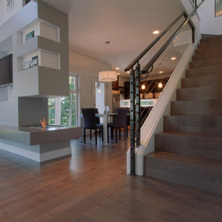Mid-sized minimalist wooden u-shaped staircase photo in Portland with wooden risers