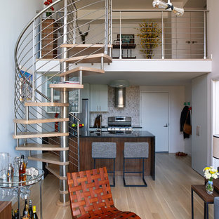 Small contemporary spiral staircase in New York with open risers.