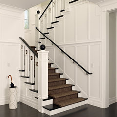 traditional staircase by Polsky Perlstein Architects