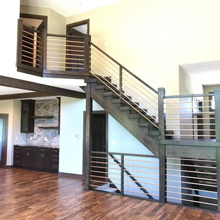 Example of a large trendy wooden u-shaped open and metal railing staircase design in Milwaukee