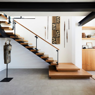 Staircase - contemporary wooden l-shaped open and glass railing staircase idea in Los Angeles