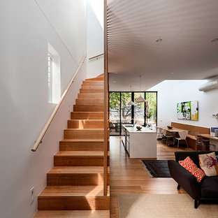 Photo of a mid-sized contemporary wood straight staircase in Melbourne with wood risers.