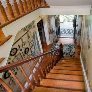 This is an example of a medium sized victorian wood straight wood railing staircase in Philadelphia with wood risers.