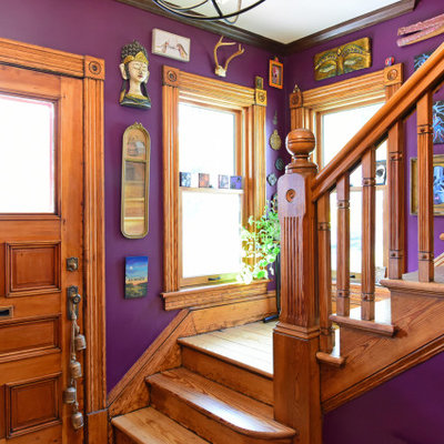 Example of an eclectic wooden l-shaped wood railing staircase design in Boston with wooden risers