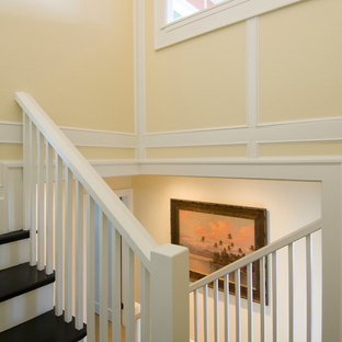 Example of a mid-sized island style painted u-shaped staircase design in Santa Barbara with painted risers