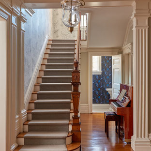 Inspiration for a transitional wooden straight wood railing staircase remodel in New York with painted risers