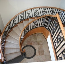 Traditional Staircase by Red Rock Pools and Spas and Red Rock Contractors