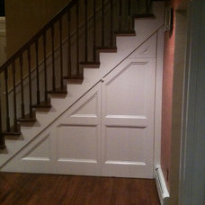 Traditional Staircase by AJS Remodeling Co.