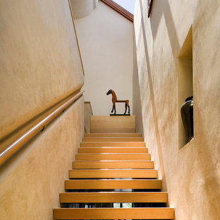 Inspiration for a mid-sized contemporary wooden l-shaped open staircase remodel in New York