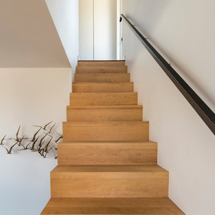 Inspiration for a small wooden l-shaped metal railing staircase remodel with wooden risers