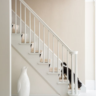 Elegant painted staircase photo in Portland Maine with painted risers