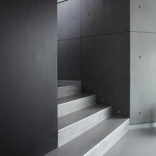 Idee per una scala a rampa dritta industriale di medie dimensioni con pedata in cemento e alzata in cemento