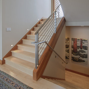 Inspiration for a contemporary wooden u-shaped metal railing staircase remodel in Portland with wooden risers